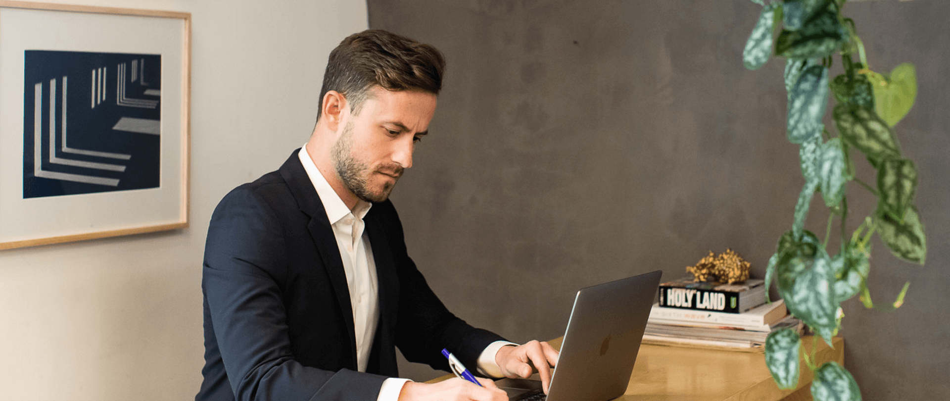 business man woking on a lap top